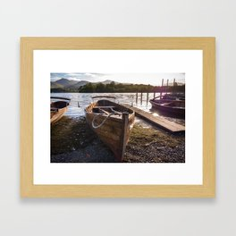 Wooden rowing boats on shore of Lake Derwentwater, England Framed Art Print