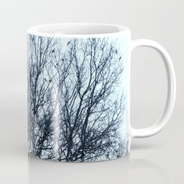A flock of birds sitting on a tree on a winter day. Coffee Mug