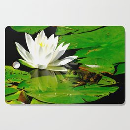 Frog with lily flower reflection Cutting Board