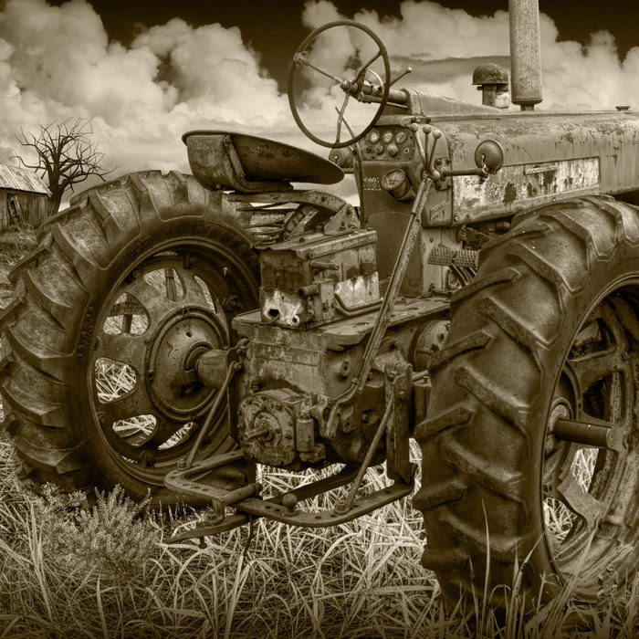 Abandoned Old Farmall Tractor in Sepia Tone Comforters