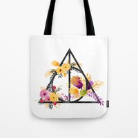 deathly hallows Tote Bags featuring Life and Deathly Hallows by Snazzy Sisters