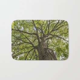looking up into the tree crown Bath Mat
