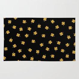 Golden shamrocks Black Background Rug