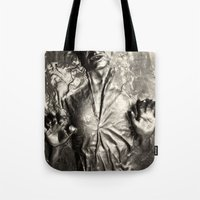 han solo Tote Bags featuring Han Solo carbonite by Ferdinand Bardamu