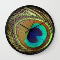peacock feather Wall Clocks featuring Peacock Feather by Kim Bajorek