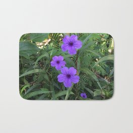 Purple flowers among green Bath Mat