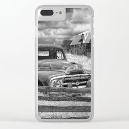 Black and White of Rusted International Harvester Pickup Truck behind wooden fence with Red Barn in Clear iPhone Case