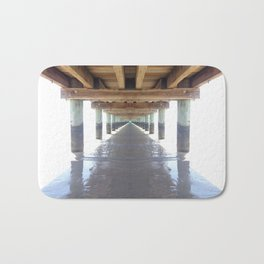 under the pier surrounded by white Bath Mat