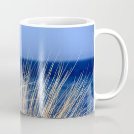 Dried long grass with blue sea behind and blue sky Coffee Mug
