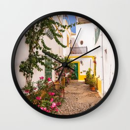 Charming cobblestone street in the whitewashed town of Tavira, Portugal Wall Clock