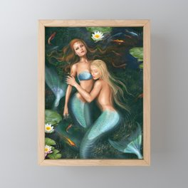 Beautiful fantasy princess mermaids in lake with lilies underwater background Framed Mini Art Print