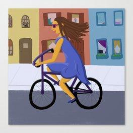 Lady in a Dress on a Bike Canvas Print