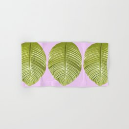 Three large green leaves on a pink background - vivid colors Hand & Bath Towel