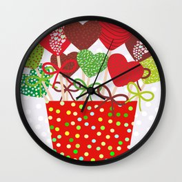 Christmas design Cake pops set with bow gray background with snowflakes. Wall Clock
