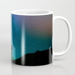 Silhouettes of a loving couple against a starry sky Coffee Mug