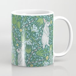 Grey hares with coltsfoots and snowdrops on green background Coffee Mug