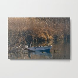 Fisherman on a boat by the river in the early morning Metal Print