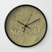 stay gold Wall Clocks featuring Stay Gold by Kelsey Roach