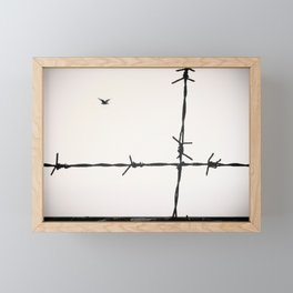 Freedom, a seagull is flying totally free beyond a spiked wire. Framed Mini Art Print