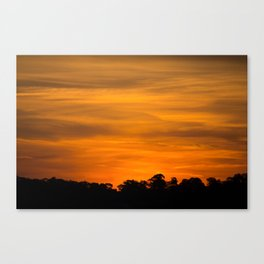 Orange Sunset Over Tree Line Canvas Print