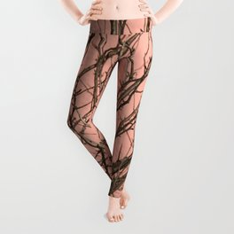 Bare tree against a pink wall Leggings