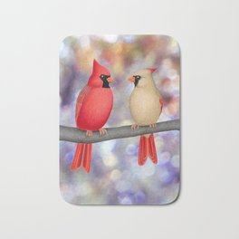 cardinals on a branch - bokeh Bath Mat