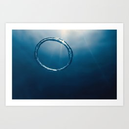 Bubble ring Underwater ascends towards the sun. Art Print