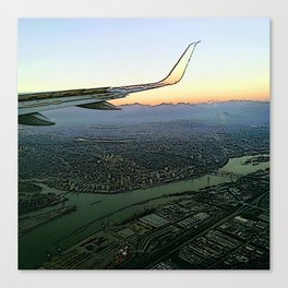 Landing together with the sun Canvas Print