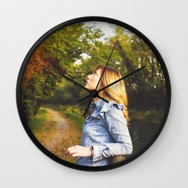 Lovely young woman in the Natural Park of Ticino Wall Clock