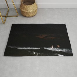 Boy and Girl playing in the waves Rug