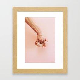hand holds donut Framed Art Print