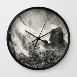 Strength against the waterfall Wall Clock