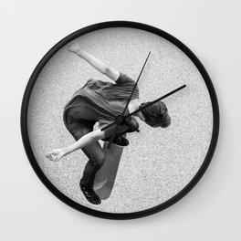 Skateboarder - Kickflip from above Wall Clock