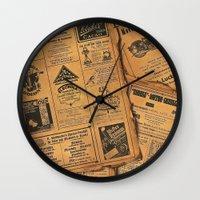 newspaper Wall Clocks featuring old newspaper by Marianna Burk