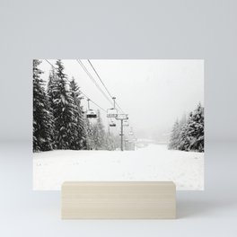 Lifts waiting for action in the snow Mini Art Print
