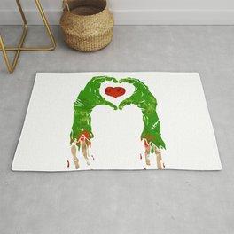 zombie hand making heart Rug