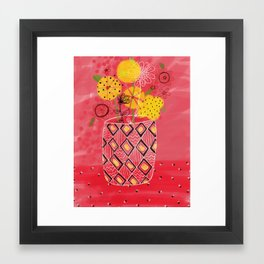 Yellow flowers in coral vase Framed Art Print
