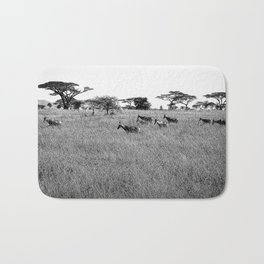 Impala in the grass Bath Mat