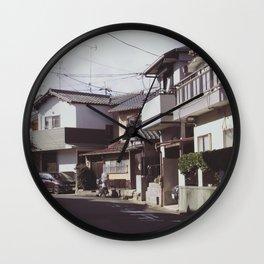 Turn left Wall Clock