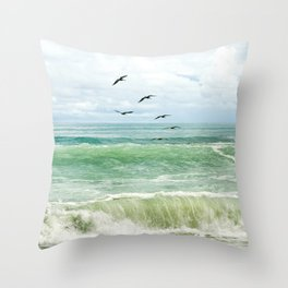 Birds flying above ocean Throw Pillow