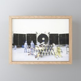 Inside the Payload Hazardous Servicing Facility at NASAs Kennedy Space Center in Florida engineers a Framed Mini Art Print