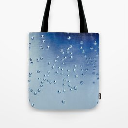 I like nonsense, it wakes up the brain cells. Fantasy is a necessary ingredient in living.-Dr. Seuss Tote Bag