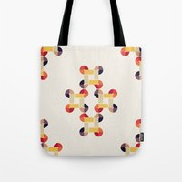Tote Bags featuring 'round and 'round  by VessDSign