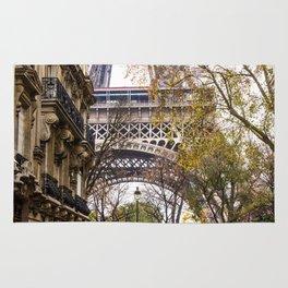 Eiffel Tower in Between Buildings Rug