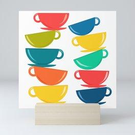 A Teetering Tower Of Colorful Tea Cups Mini Art Print