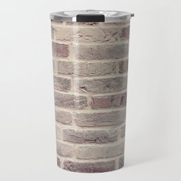 Wall built with bricks of various earth tones Travel Mug