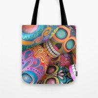 sugar skulls Tote Bags featuring sugar skulls by wet yeti