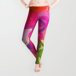 Cool colorful graffiti print in electric bright tones with two strange faces Leggings