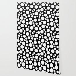 White polka dots on a black background. Wallpaper