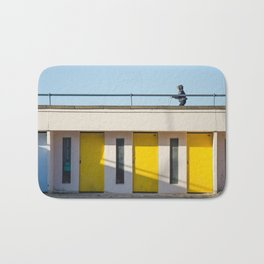 In scooter, yellow cabins Bath Mat